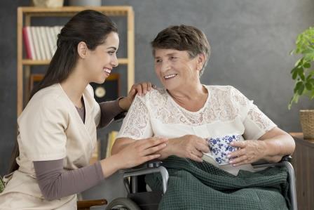 Smiling senior woman drinking tea